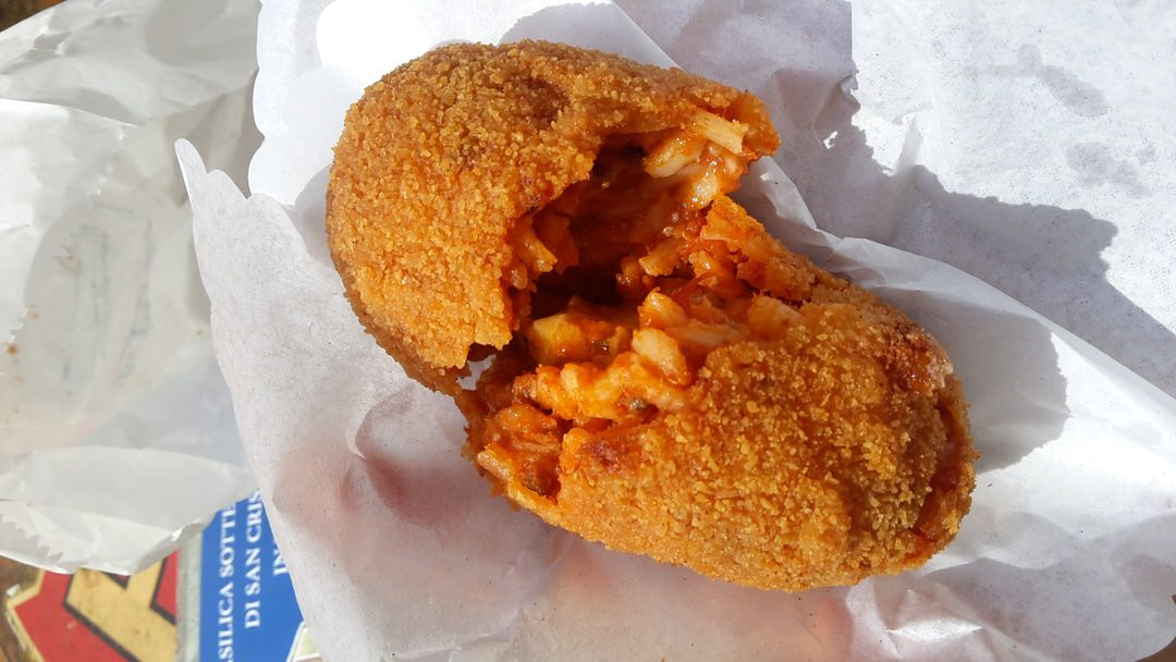 A delicious suppli, a popular street snack in Naples, Italy.